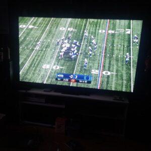 Football Spiel auf dem Fernsehr